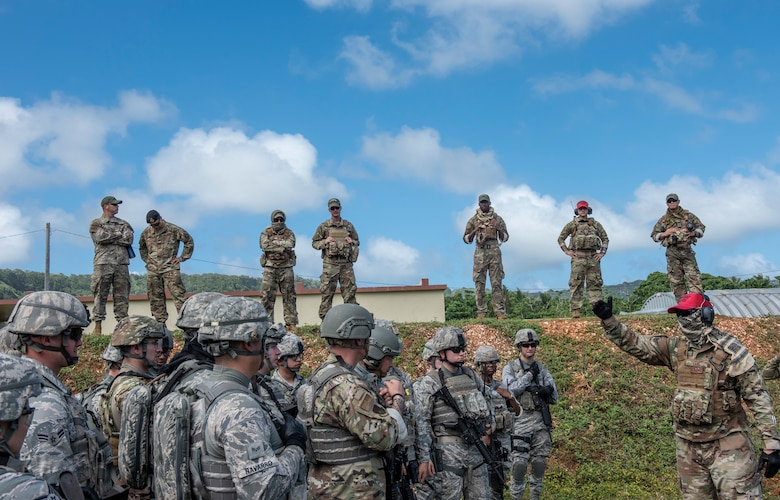 Students await instruction during tier 1 and 2 Commando Warrior training at North West Field near Andersen Air Force Base, Guam Dec. 10, 2018. The 14-day course was hosted by the 736th Security Forces Squadron and encompassed convoy operations, counter improvised explosive devices, navigation, advanced weapons tactics, and other skills to promote base and mobile security. (U.S. Air Force photo by Master Sgt. JT May III)