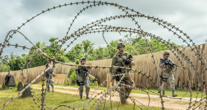 Security Force members conduct foot patrols during tier 1 and 2 Commando Warrior training at North West Field near Andersen Air Force Base, Guam Dec. 11, 2018. The training was hosted by the 736th Security Forces Squadron as part of the CSAF's Year of the Defender initiative. Sixty-eight active duty and Air National Guard members graduated from the 14-day course Dec. 14, 2018. (U.S. Air Force photo by Master Sgt. JT May III)