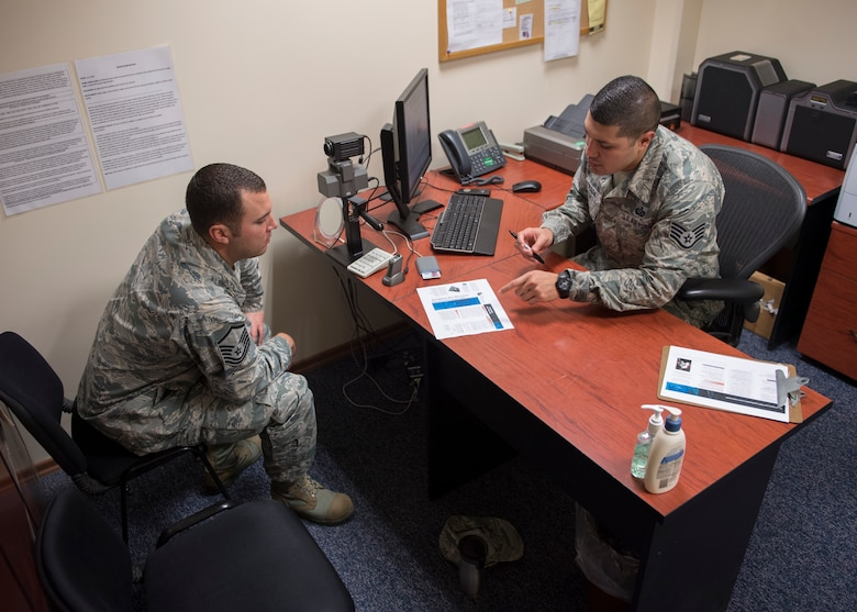 U.S. Air Force Staff Sgt. Maximiliano Estrada, 39th Force Support Squadron Military Personnel Flight NCO in charge of customer service, creates a new ID for a customer at Incirlik Air Base, Turkey, Nov. 27, 2018.