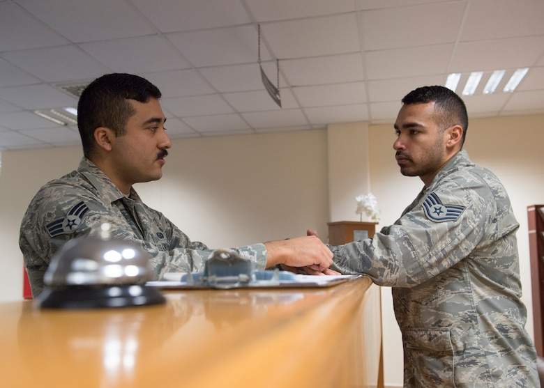 U.S. Air Force Senior Airman Noe Castillo, 39th Force Support Squadron Military Personnel Flight career development technician, speaks with a customer at Incirlik Air Base, Turkey, Nov. 27, 2018.
