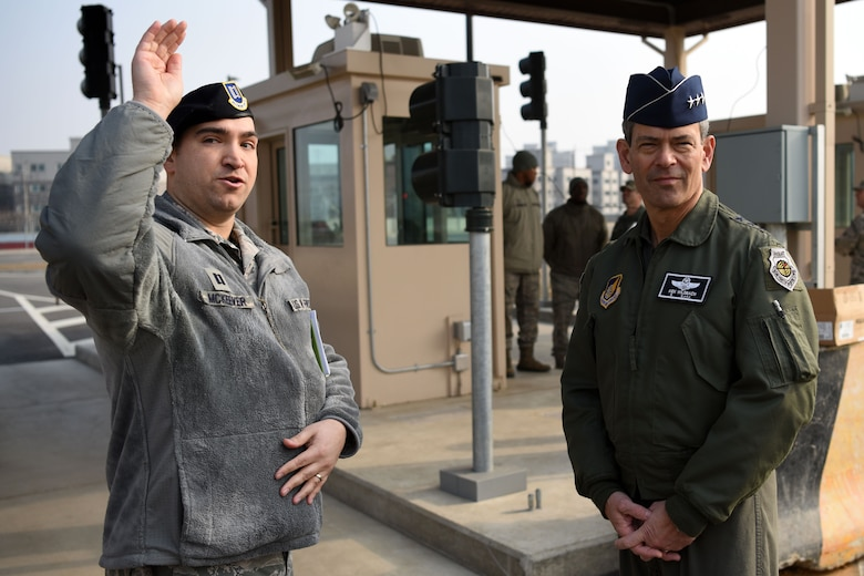 U.S. Air Force Lt. Gen. Kenneth Wilsbach, 7th AF commander, speaks with Capt. Lance McKeever, 51st Security Forces Squadron deputy commander, about the newly opened Morin Gate during an immersion tour at Osan Air Base, Republic of Korea, Jan. 11, 2019. The improved Morin Gate took the place of the Doolittle Gate, with better antiterrorism and force protection measures while increasing throughput capacity and traffic control. (U.S. Air Force photo by Senior Airman Kelsey Tucker)