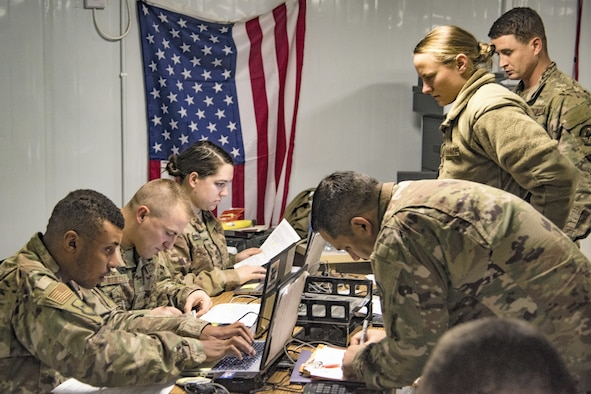 .Airmen of the 332nd Air Expeditionary Wing Financial Management team assist new arrivals during in-processing January 10, 2019.  As the commander's principal advisor on funding and fiscal issues, FM oversees all the expenditures to enable mission execution and serves as the focal point for assigned members on matters of military and travel pay. (U.S. Air Force photo by Staff Sgt. Stephen G. Eigel)