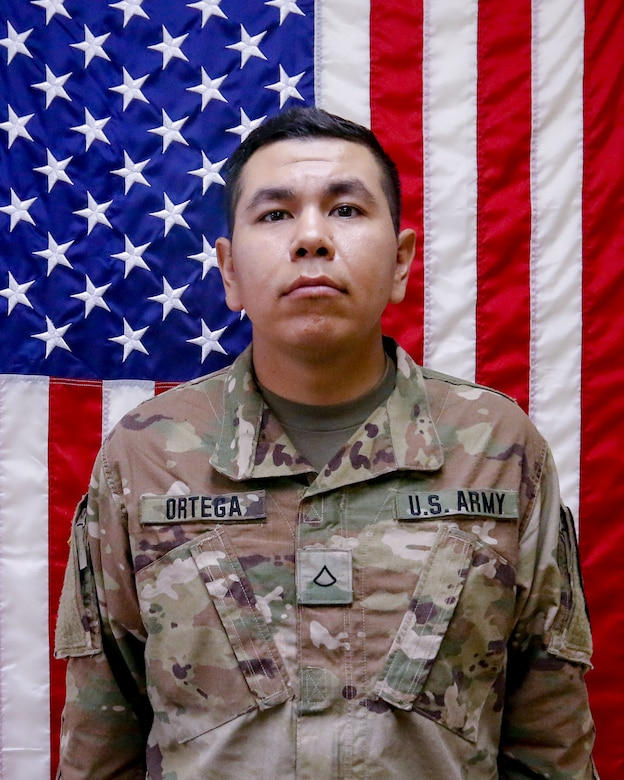Spc. Andrew Ortega in a unit photo taken prior to deployment.