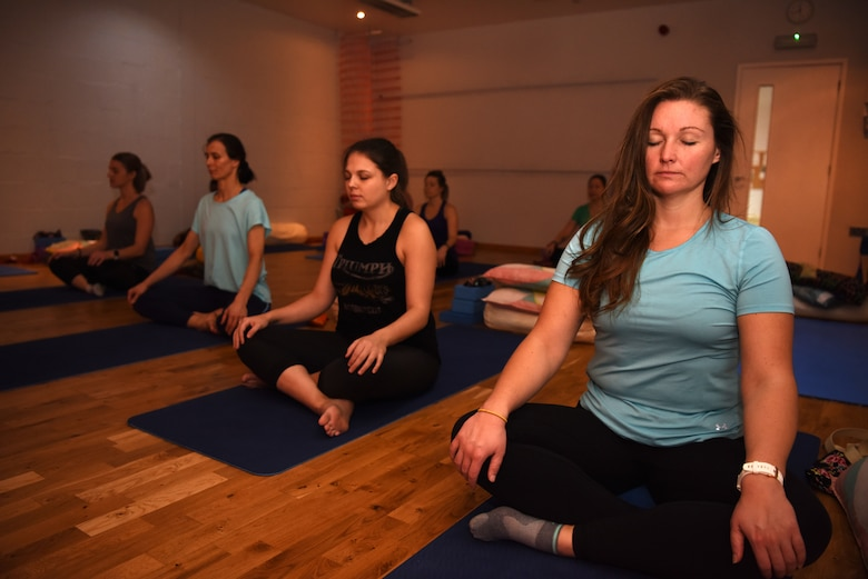 Team Mildenhall spouses take part in a Yin yoga session at a local yoga studio in Newmarket, England, Jan. 10, 2019. The yoga session was part of a Resiliency and Mindfulness Event hosted by Jack Sweet, RAF Mildenhall Community Support Coordinator, and RAFM Key Spouses organization. (U.S. Air Force photo by Airman 1st Class Brandon Esau)