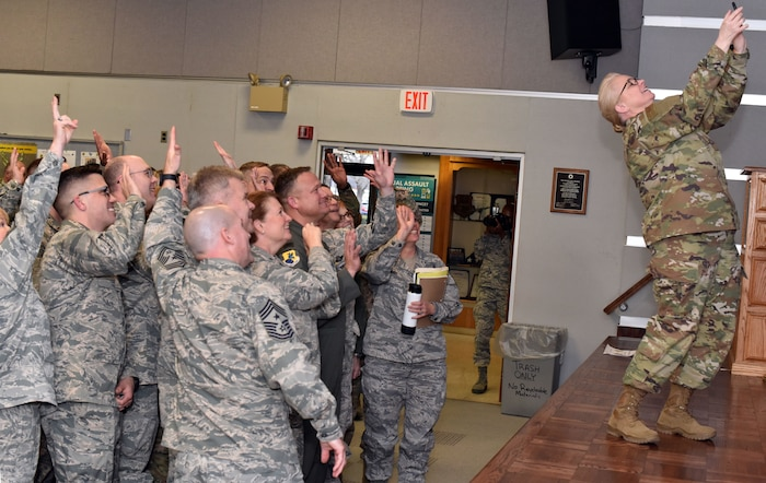 Members from the 166th Airlift Wing pose for a photo with the Delaware State Command Chief, Patricia Ann Ottinger at New Castle Air National Guard Base, Del., Jan 12, 2019. After closing remarks at the Senior Leader Conference, the Army and Air National Guard attended separate breakout sessions with their respective service to discuss topics specific to their branch of service.
