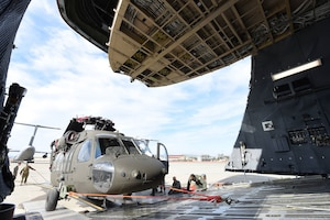 A U.S. Army UH-60 Black Hawk is loaded into a C-5M Super Galaxy as part of full-spectrum readiness training January 13 at Travis Air Force Base, Calif. The Black Hawks' normal transport is the C-17 Globemaster III, but the C-5M was offered as transport to the Army in the interest of full-spectrum readiness training for Travis' C-5M personnel. (U.S. Air Force photo by Airman 1st Class Christian Conrad)