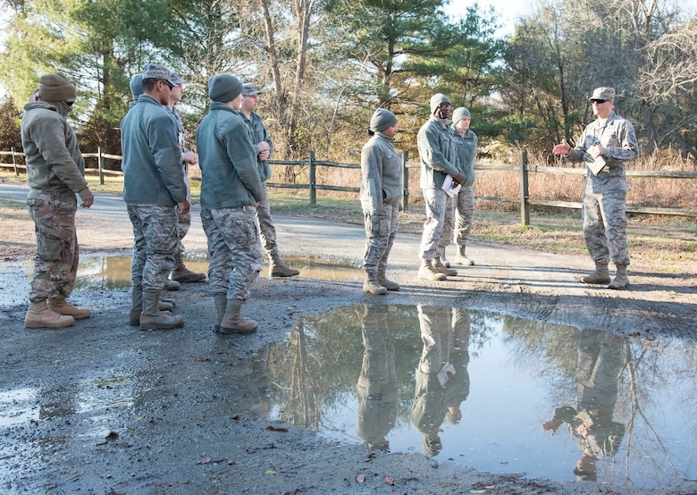 Master Sgt. Jason McNabb, 436th Civil Engineer Squadron engineering flight superintendent, briefs engineering assistants prior to an aircraft mishap survey exercise Dec. 18, 2018, near Killens Pond State Park, Kent County, Del. McNabb briefed the EA survey team of a simulated T-38 Talon aircraft mishap. (U.S. Air Force photo by Roland Balik)