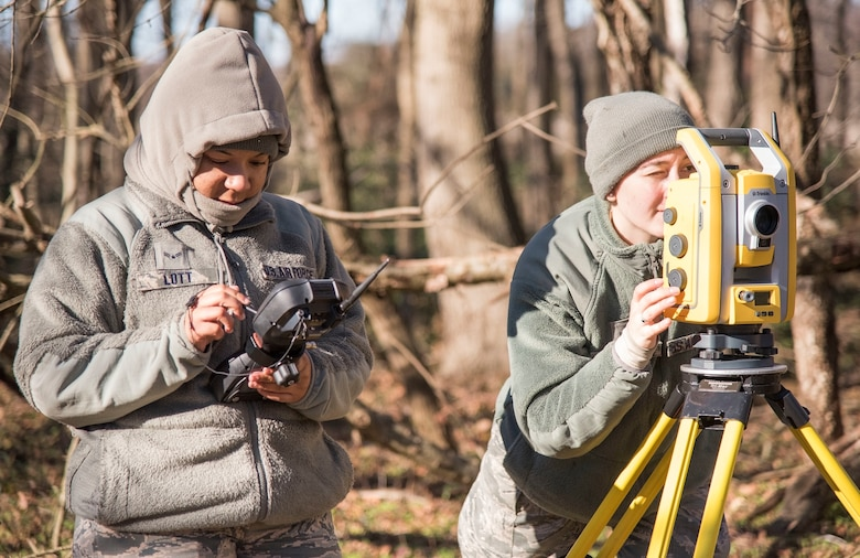 Airman 1st Class Alishia Lott and Angela Schnedler, 436th Civil Engineer Squadron engineering journeymen use surveying equipment to record debris location during an aircraft mishap survey exercise Dec. 18, 2018, near Killens Pond State Park, Kent County, Del. Lott and Schnedler documented the exact location of miscellaneous aircraft and aircrew items of a simulated T-38 Talon aircraft mishap using GPS satellites. (U.S. Air Force photo by Roland Balik)