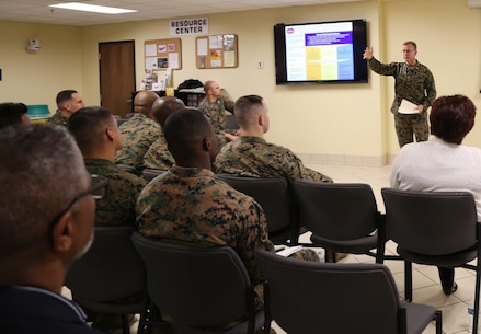 Brig. Gen. Joseph F. Shrader, commanding general, Marine Corps Logistics Command, discusses his priorities and key objectives for 2019 with Marines and civilian-Marines during a town hall meeting held in LOGCOM's Multi-Purpose Room, Jan. 8.