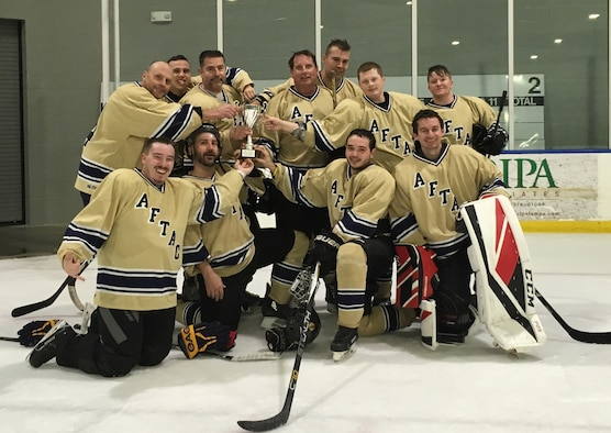 Members of the Athletes for Teamwork and Charity Hockey Club pose for a team photo after their tournament win against the Northeast Indiana Warbirds and the Tampa Warriors. The team is made up of players who work at the Air Force Technical Applications Center, Patrick AFB, Fla.  (Courtesy photo)