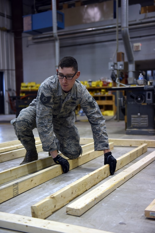 Tech. Sgt. Seth Maurer, a structures specialist with the 201st RED HORSE, Fort Indiantown Gap, Pennsylvania, puts together the frame of a wall to complete training requirements Oct. 28, 2018. Maurer has been with the 201st RHS since 2014 when he separated from active-duty and moved to Pennsylvania with his family. (U.S. Air National Guard photo by Senior Airman Julia Sorber/Released)