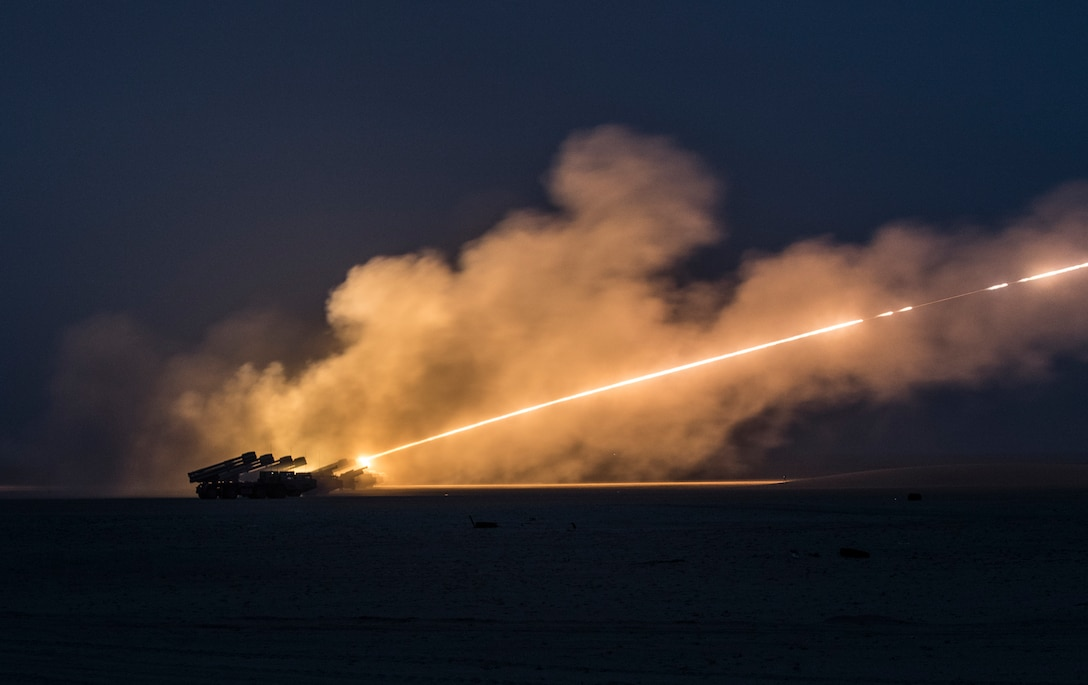 U.S. Soldiers assigned to the 65th Field Artillery Brigade, and soldiers from the Kuwait Land Forces fire their High Mobility Artillery Rocket Systems (U.S.) and BM-30 Smerch rocket systems (Kuwait) during a joint live-fire exercise, Jan. 8, 2019, near Camp Buehring, Kuwait. The U.S. and Kuwaiti forces train together frequently to maintain a high level of combat readiness and to maintain effective communication between the two forces. (U.S. Army photo by Sgt. James Lefty Larimer)
