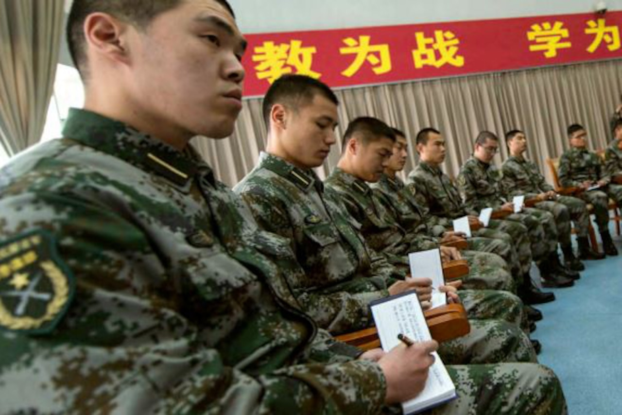 Chinese soldiers in a seminar setting