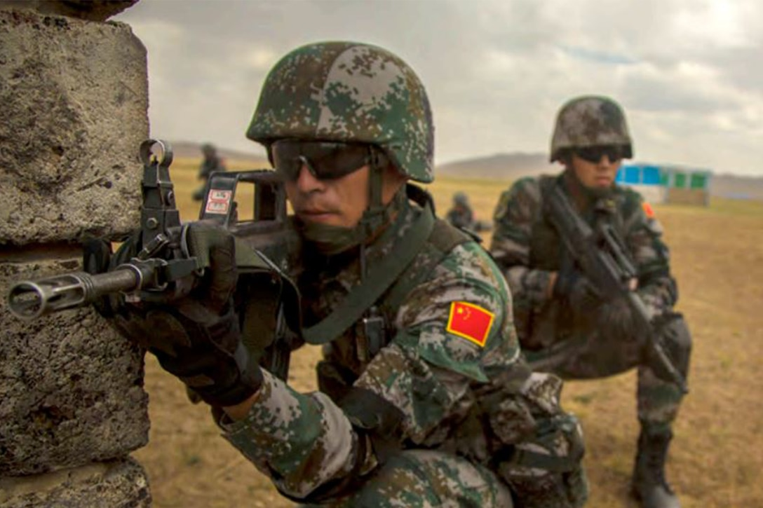 Chinese soldiers crouch during movement training.