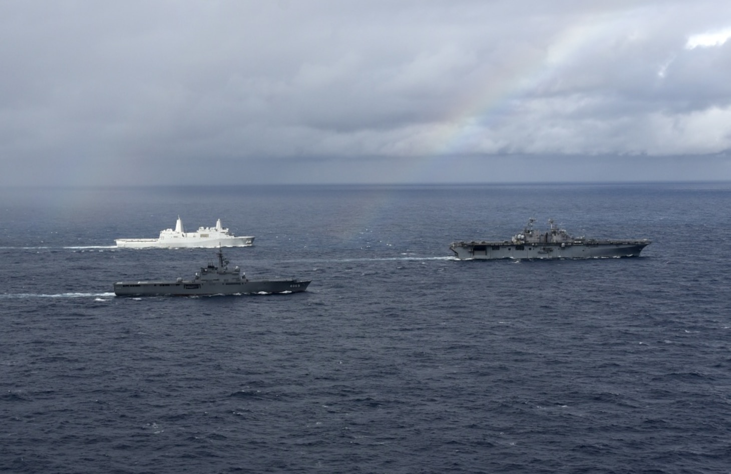EAST CHINA SEA (Jan. 12, 2019) – The amphibious transport dock ship USS Green Bay (LPD 20) Japan Maritime Self-Defense Force amphibious transport dock ship JS Kunisaki (LST 4003), and amphibious assault ship USS Wasp (LHD 1) transit in formation during a cooperative deployment. Wasp, flagship of Wasp Amphibious Ready Group, is operating in the Indo-Pacific region to enhance interoperability with partners and serve as a ready-response force for any type of contingency