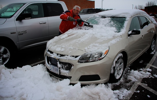 Mr. Ron Peterson, 932nd Mission Support Group, removes snow and ice from a wing staff car at the 932nd Airlift Wing Headquarters on Jan. 14, 2019, Scott Air Force Base, Illinois.  Peterson also put down pre-snow treatments on the sidewalks around the unit as the storm started coming in the Friday prior to the 12-13 January weekend.  The area received a heavy snowfall and forced the cancellation of the unit's January training assembly.
