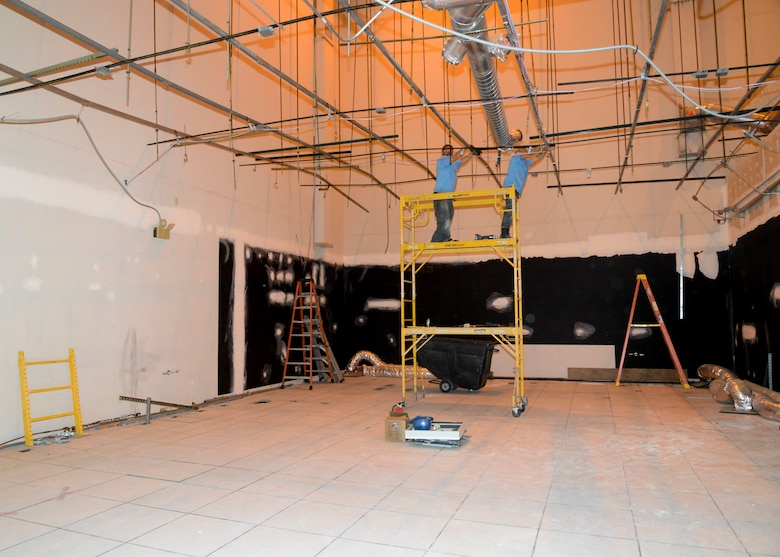 A construction crew works inside building 1020 to prepare the 412th Electronic Warfare Group for the Joint Simulation Environment computer systems and simulators. A 70,000 square foot JSE facility will be built, however engineers are installing a scaled-down version inside building 1020 to allow engineers time to fully integrate and learn about the new system. (U.S. Air Force photo by Giancarlo Casem)