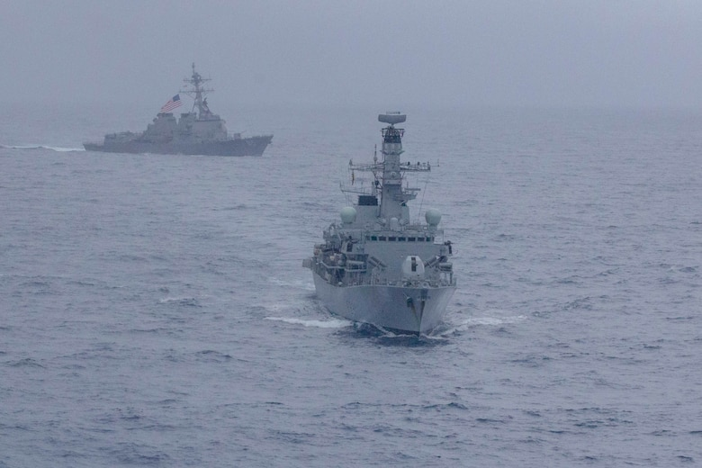 190115-N-WK982-1420 SOUTH CHINA SEA (Jan. 15, 2019) The Arleigh Burke-class guided-missile destroyer USS McCampbell (DDG 85) and the Royal Navy Type 23 'Duke' Class guided-missile frigate HMS Argyll (F231) maneuver during a divisional tactics exercise. McCampbell is forward-deployed to the U.S. 7th Fleet area of operations in support of security and stability in the Indo-Pacific region.
