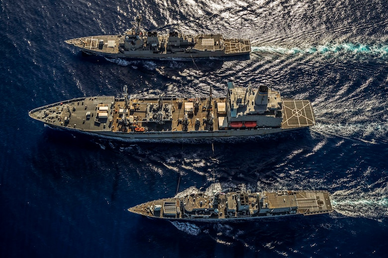SOUTH CHINA SEA (Jan. 12, 2019) The Arleigh Burke-class guided-missile destroyer USS McCampbell (DDG 85), the Military Sealift Command fleet replenishment oiler USNS Henry J. Kaiser (T-AO 187), and the Royal Navy Type 23 'Duke' Class guided-missile frigate HMS Argyll (F231) transit during a replenishment-at-sea. McCampbell is forward-deployed to the U.S. 7th Fleet area of operations in support of security and stability in the Indo-Pacific region.