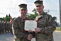 Petty Officer 1st Class Jackson Dehn, a hospital corpsman with 3rd Medical Battalion, 3rd Marine Logistics Group, receives a Navy and Marine Corps Achievement Medal from Brig. Gen. Keith D. Reventlow, commanding general of 3rd MLG, Jan 15, 2019 at Camp Foster, Okinawa, Japan. Dehn was recognized by Reventlow after winning Senior Sailor of the Year for 3rd MLG. Each year, enlisted sailors across III Marine Expeditionary Force compete at the battalion, regimental and major subordinate command levels for Blue Jacket, Sailor and Senior Sailor of the Year. (U.S. Marine Corps photo by Sgt. Tiffany Edwards)