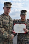 Petty Officer 2nd Class Deika Valerio, a hospital corpsman with 3rd Medical Battalion, 3rd Marine Logistics Group, receives a Navy and Marine Corps Achievement Medal from Brig. Gen. Keith D. Reventlow, commanding general of 3rd MLG, Jan 15, 2019 at Camp Foster, Okinawa, Japan. Valerio was recognized by Reventlow after winning Sailor of the Year for 3rd MLG. Each year, enlisted sailors across III Marine Expeditionary Force compete at the battalion, regimental and major subordinate command levels for Blue Jacket, Sailor and Senior Sailor of the Year. (U.S. Marine Corps photo by Sgt. Tiffany Edwards)