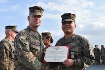 Seaman Rock Ignacio, a hospital corpsman with 3rd Medical Battalion, 3rd Marine Logistics Group, receives a Navy and Marine Corps Achievement Medal from Brig. Gen. Keith D. Reventlow, commanding general of 3rd MLG, Jan 15, 2019 at Camp Foster, Okinawa, Japan. Ignacio was recognized by Reventlow after winning Blue Jacket of the Year for 3rd MLG. Each year, enlisted sailors across III Marine Expeditionary Force compete at the battalion, regimental and major subordinate command levels for Blue Jacket, Sailor and Senior Sailor of the Year. Ignacio is a native of Dededo, Guam. (U.S. Marine Corps photo by Sgt. Tiffany Edwards)