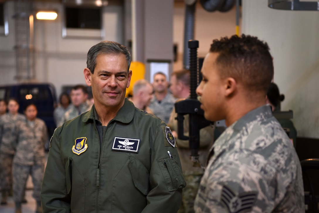 U.S. Air Force Lt. Gen. Kenneth Wilsbach, 7th AF commander, speaks with Staff Sgt. Michael Clark, 51st Logistics Readiness Squadron fuels knowledge operations specialist, during an immersion tour at Osan Air Base, Republic of Korea, Jan. 11, 2019. Clark spoke about subjects regarding the fuels management flight personnel, facilities, and scope of responsibility. (U.S. Air Force photo by Senior Airman Kelsey Tucker)