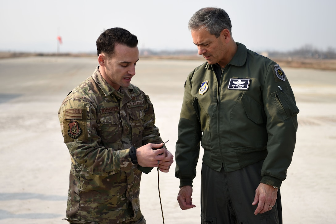 U.S. Air Force Lt. Gen. Kenneth Wilsbach, 7th AF commander, speaks with Master Sgt. Layne Mayerstein, 51st Civil Engineer Squadron explosive ordnance disposal flight chief, during an immersion tour at Osan Air Base, Republic of Korea, Jan. 11, 2019. Mayerstein spoke about the EOD side of Rapid Airfield Damage Repair, including methods of dealing with unexploded explosive ordnance on the flightline. (U.S. Air Force photo by Senior Airman Kelsey Tucker)