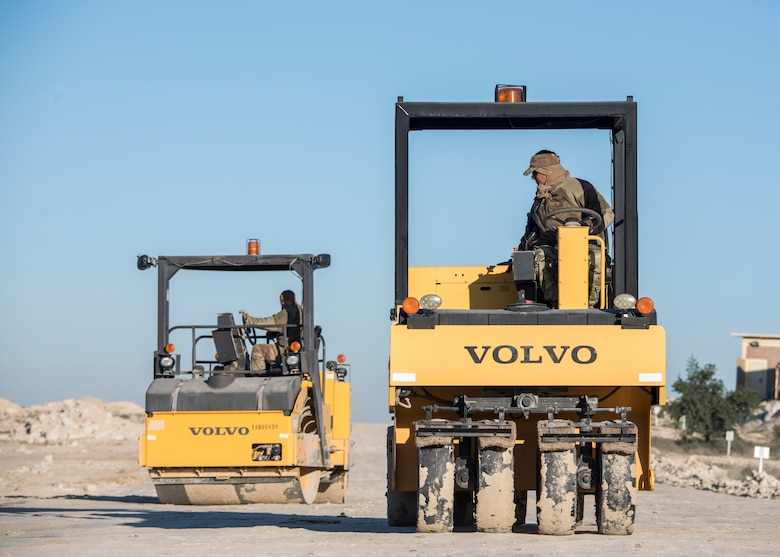 Tech. Sgt. Robert Hall, 386th Expeditionary Civil Engineer Squadron pavement and equipment journeyman, levels the dirt in preparation for the final stages of construction at an undisclosed location in Southwest Asia, Jan. 10, 2019. The road will help minimize the amount of traffic through the heart of base after it is completed.