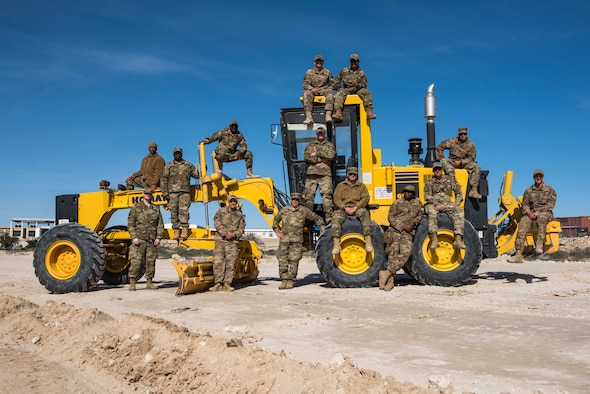 Airmen from the 386th Expeditionary Civil Engineer Squadron pose for a photo at an undisclosed location in Southwest Asia, Jan. 10, 2019. Airmen from this rotation have continued the work from the last rotation and have connected the road to its endpoint.