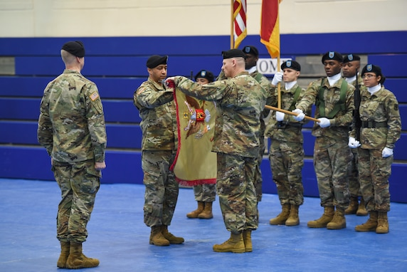The command group of 589th Brigade Support Battalion (589th BSB) unfurls the unit colors during the activation ceremony of 589th BSB at the 7th Army Training Command's Grafenwoehr Training Area, Germany, Jan. 11, 2019.
