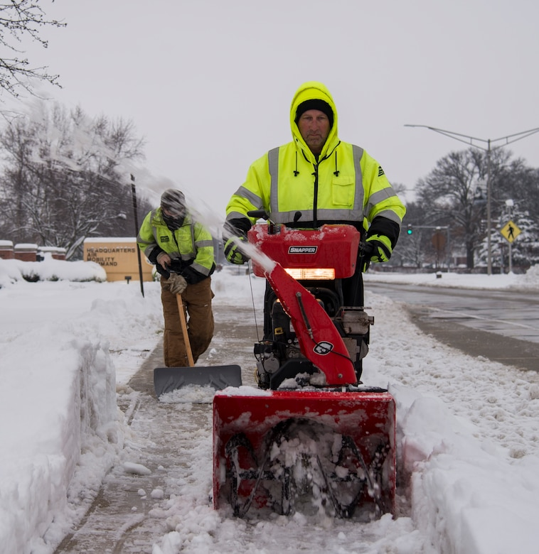 Members of the Ability One Program ground maintenance, clear the sidewalk in front of Air Mobility Command Headquarters, Jan. 12, 2019, at Scott Air Force Base, Ill. Members of the Ability One Program assisted with snow and ice removal alongside members of the 375th Civil Engineer Squadron.