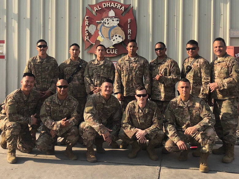 The 380th Expeditionary Civil Engineer Squadron firefighters take a group photo Dec. 24, 2018 at Al Dhafra Air Base, United Arab Emirates.