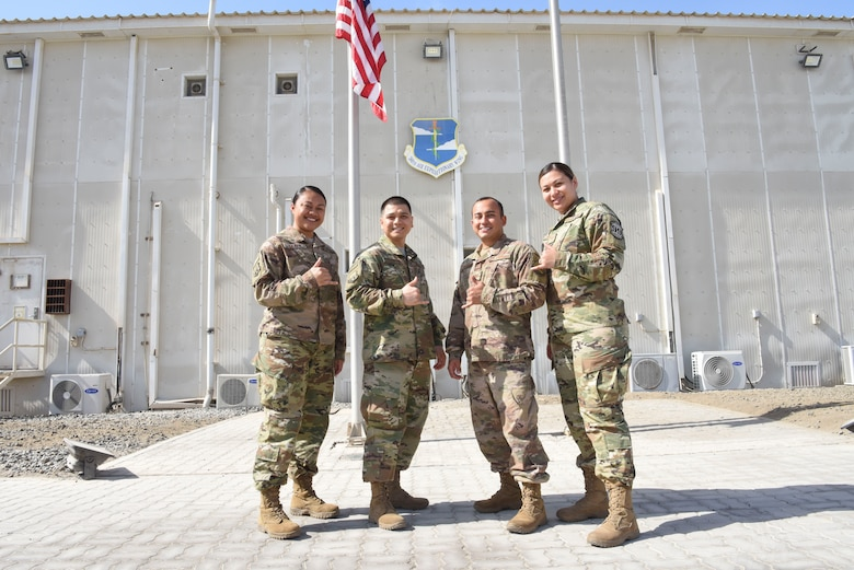 Knowledge Operation Managers and Reservists Senior Airman Demelsa Leafa, 380th Air Expeditionary Wing command chief executive, Senior Airman Coby Schaefer, 380th Expeditionary Civil Engineer Squadron commander administrator, Tech. Sgt. Jean-Paul Zelaya-Rios, 909th Expeditionary Air Refueling Squadron commander administrator, and Senior Airman Samantha Mays, 99th Expeditionary Reconnaissance Squadron commander administrator, take a group photo Jan. 9, 2019 at Al Dhafra Air Base, United Arab Emirates.