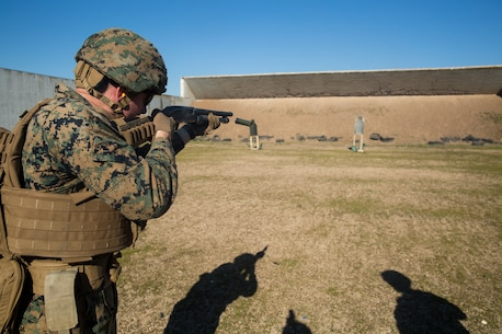 A U.S. Marine with Special Purpose Marine Air-Ground Task Force-Crisis Response-Africa fires a shotgun during a breaching range at Morón Air Base, Spain, Jan. 7, 2019. SPMAGTF-CR-AF is a rotational force deployed to conduct crisis-response and theater-security operations in Europe and Africa. (U.S. Marine Corps photo by Sgt. Katelyn Hunter)