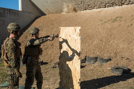 A U.S. Marine with Special Purpose Marine Air-Ground Task Force-Crisis Response-Africa fires a shotgun into a training door during a breaching range at Morón Air Base, Spain, Jan. 7, 2019. SPMAGTF-CR-AF is a rotational force deployed to conduct crisis-response and theater-security operations in Europe and Africa. (U.S. Marine Corps photo by Sgt. Katelyn Hunter)