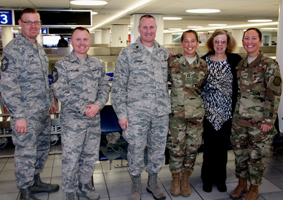 Members of the 932nd Airlift Wing staff and 932nd Medical Group welcomed back unit members from a recent deployment on January 14, 2019.  It's been a busy 12 months as various deployers have come and gone from a wide variety of specialties within the Illinois unit.  The 932nd Airlift Wing is constantly training and equipping reservists from 37 states, who come once a month for Unit Training Assembly weekends and annual tours at Scott Air Force Base, Illinois.  (U.S. Air Force photo by Lt. Col Stan Paregien)