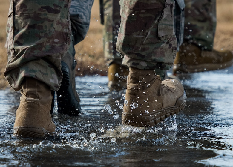 Members of the 633rd Security Forces Squadron, Air Force Office of Special Investigation and Naval Criminal Investigative Services conduct a ruck march in memory of joint patrol team Hustler 6 at Joint Base Langley-Eustis, Virginia, Dec. 21, 2018.