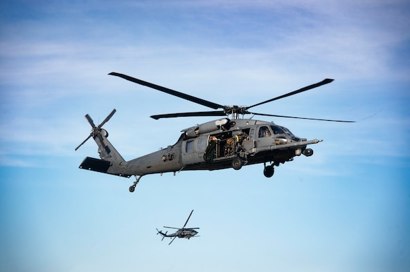 HH-60G Pave Hawks from the 41st Rescue Squadron (RQS) execute tactical maneuvers during a pre-deployment 'spin-up' exercise, Dec. 12, 2018, at Avon Park Air Force Range, Fla. During this pre-deployment 'spin-up' training, Moody's 347th Rescue Group tested and maximized their combat search and rescue (CSAR) and personnel recovery capabilities. Under normal circumstances, the HH-60G Pave Hawk helicopter crews and maintainers deploy from Moody and integrate with Guardian Angel teams from different bases. This time, Moody's 38th RQS and 41st RQS's will deploy together and utilized this exercise to improve their mission readiness and cohesion before their departure. (U.S. Air Force photo by Senior Airman Greg Nash)