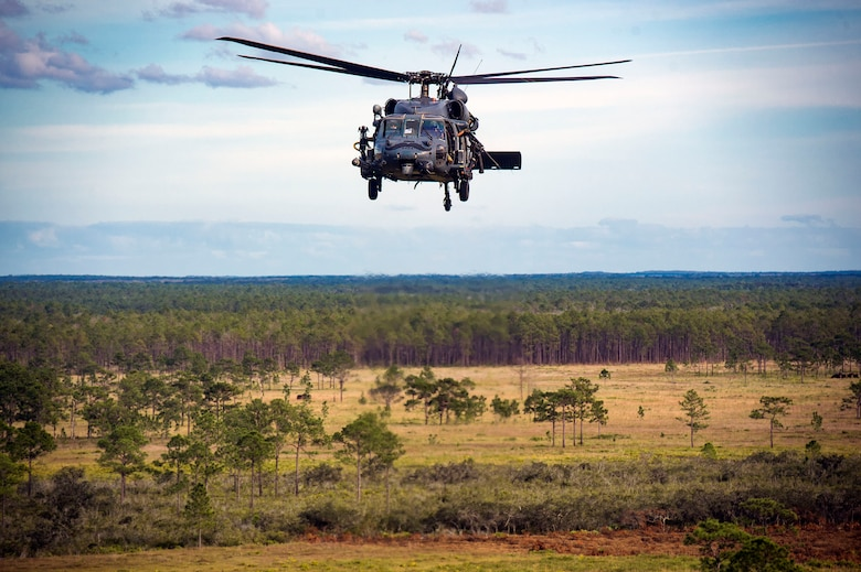A 41st Rescue Squadron HH-60G Pave Hawk navigates over a mock battlefield during pre-deployment 'spin-up' training, Dec. 12, 2018, at Avon Park Air Force Range, Fla. During this pre-deployment 'spin-up' training, Moody's 347th Rescue Group tested and maximized their combat search and rescue (CSAR) and personnel recovery capabilities. Under normal circumstances, the HH-60G Pave Hawk helicopter crews and maintainers deploy from Moody and integrate with Guardian Angel teams from different bases. This time, Moody's 38th RQS and 41st RQS's will deploy together and utilized this exercise to improve their mission readiness and cohesion before their departure. (U.S. Air Force photo by Senior Airman Greg Nash)