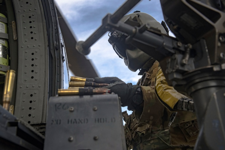 A 41st Rescue Squadron special missions aviator loads ammunition into an M2 machine gun mount on an HH-60G Pave Hawk during pre-deployment 'spin-up' training, Dec. 12, 2018, at Avon Park Air Force Range, Fla. During this pre-deployment 'spin-up' training, Moody's 347th Rescue Group tested and maximized their combat search and rescue (CSAR) and personnel recovery capabilities. Under normal circumstances, the HH-60G Pave Hawk helicopter crews and maintainers deploy from Moody and integrate with Guardian Angel teams from different bases. This time, Moody's 38th RQS and 41st RQS's will deploy together and utilized this exercise to improve their mission readiness and cohesion before their departure. (U.S. Air Force photo by Senior Airman Greg Nash)