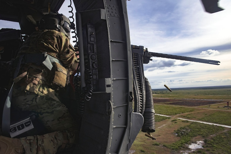 A 41st Rescue Squadron (RQS) special missions aviator fires an M2 machine gun from an HH-60G Pave Hawk during pre-deployment 'spin-up' training, Dec. 12, 2018, at Avon Park Air Force Range, Fla. During this pre-deployment 'spin-up' training, Moody's 347th Rescue Group tested and maximized their combat search and rescue (CSAR) and personnel recovery capabilities. Under normal circumstances, the HH-60G Pave Hawk helicopter crews and maintainers deploy from Moody and integrate with Guardian Angel teams from different bases. This time, Moody's 38th RQS and 41st RQS's will deploy together and utilized this exercise to improve their mission readiness and cohesion before their departure. (U.S. Air Force photo by Senior Airman Greg Nash)