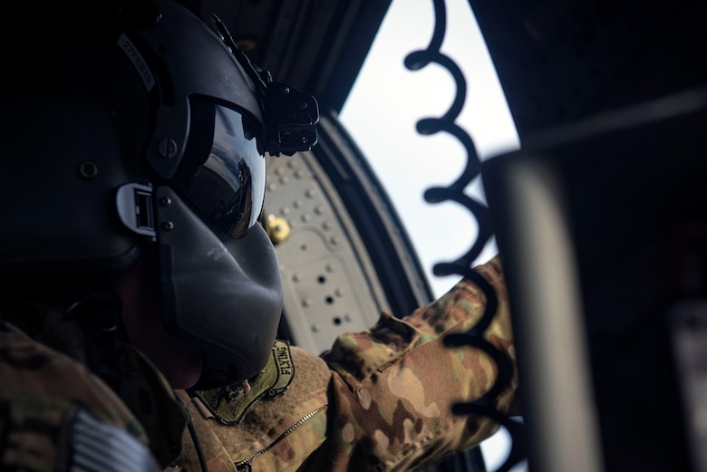 A 41st Rescue Squadron (RQS) special missions aviator scans a mock battlefield from an HH-60G Pave Hawk during pre-deployment 'spin-up' training, Dec. 12, 2018, at Avon Park Air Force Range, Fla. During this pre-deployment 'spin-up' training, Moody's 347th Rescue Group tested and maximized their combat search and rescue (CSAR) and personnel recovery capabilities. Under normal circumstances, the HH-60G Pave Hawk helicopter crews and maintainers deploy from Moody and integrate with Guardian Angel teams from different bases. This time, Moody's 38th RQS and 41st RQS's will deploy together and utilized this exercise to improve their mission readiness and cohesion before their departure. (U.S. Air Force photo by Senior Airman Greg Nash)