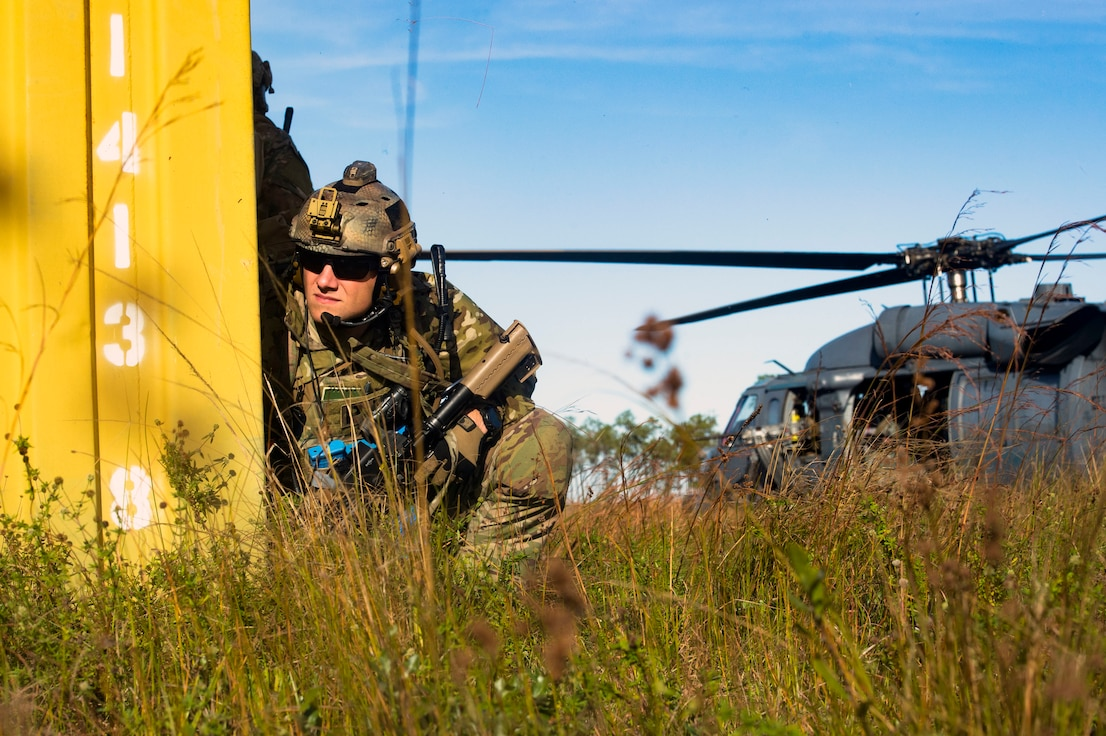 A pararescueman from the 38th Rescue Squadron (RQS) scans a mock battlefield during pre-deployment 'spin-up' training, Dec. 12, 2018, at Avon Park Air Force Range, Fla. During this pre-deployment 'spin-up' training, Moody's 347th Rescue Group tested and maximized their combat search and rescue (CSAR) and personnel recovery capabilities. Under normal circumstances, the HH-60G Pave Hawk helicopter crews and maintainers deploy from Moody and integrate with Guardian Angel teams from different bases. This time, Moody's 38th RQS and 41st RQS's will deploy together and utilized this exercise to improve their mission readiness and cohesion before their departure. (U.S. Air Force photo by Senior Airman Greg Nash)