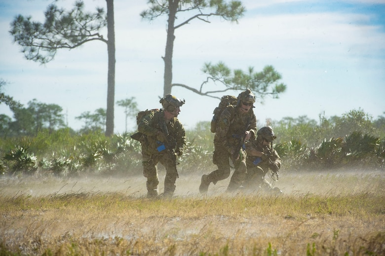 Pararescuemen from the 38th Rescue Squadron (RQS) advance a mock battlefield to rescue personnel during pre-deployment 'spin-up' training, Dec. 12, 2018, at Avon Park Air Force Range, Fla. During this pre-deployment 'spin-up' training, Moody's 347th Rescue Group tested and maximized their combat search and rescue (CSAR) and personnel recovery capabilities. Under normal circumstances, the HH-60G Pave Hawk helicopter crews and maintainers deploy from Moody and integrate with Guardian Angel teams from different bases. This time, Moody's 38th RQS and 41st RQS's will deploy together and utilized this exercise to improve their mission readiness and cohesion before their departure. (U.S. Air Force photo by Senior Airman Greg Nash)