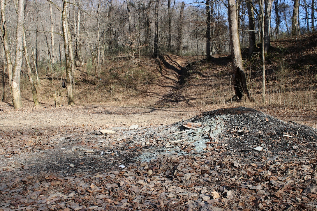 Soil erosion along a path of an off-road vehicle can be seen Jan. 11, 2019 in the background of an illegal trash and fire site at Cane Hollow at Center Hill Lake.  (USACE photo by Ashley Webster)