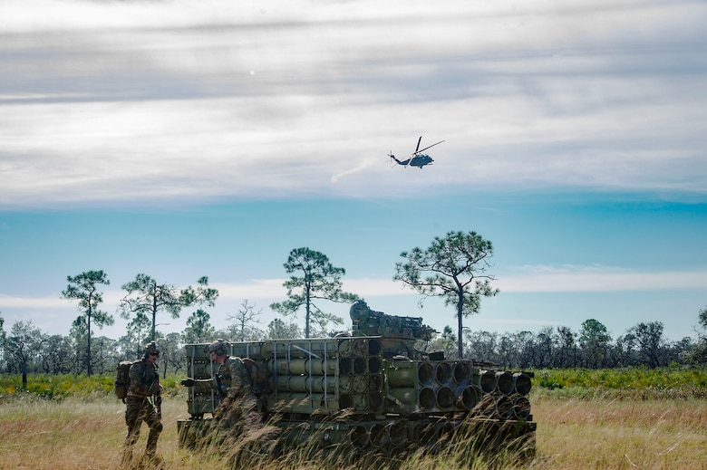 Pararescuemen from the 38th Rescue Squadron position themselves on a mock battlefield during a pre-deployment 'spin-up' exercise, Dec. 12, 2018, at Avon Park Air Force Range, Fla. During this pre-deployment 'spin-up' training, Moody's 347th Rescue Group tested and maximized their combat search and rescue (CSAR) and personnel recovery capabilities. Under normal circumstances, the HH-60G Pave Hawk helicopter crews and maintainers deploy from Moody and integrate with Guardian Angel teams from different bases. This time, Moody's 38th RQS and 41st RQS's will deploy together and utilized this exercise to improve their mission readiness and cohesion before their departure. (U.S. Air Force photo by Senior Airman Greg Nash)