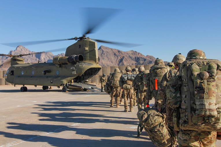 Soldiers line up to get aboard a helicopter in Afghanistan.