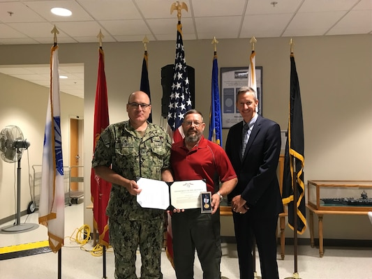 NSWC Crane employee was awarded one of the highest civilian honors for an act of bravery overseas. William (Bill) Taylor, an AC-130W Weapons Specialist at NSWC Crane, received the Command Civilian Service Medal for Valor and Courage in a combat zone for saving seven lives and extinguishing a fire.