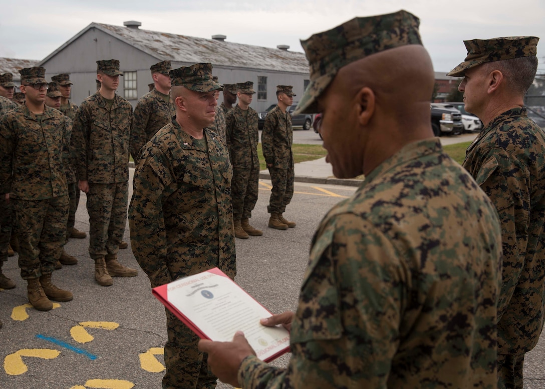 U.S. Marine Corps Sgt. Maj. Cortez L. Brown, sergeant major of 6th Marine Corps District, reads the promotion warrant for Chief Warrant Officer Matthew Kessinger, personnel officer of 6th MCD, during Kessinger's promotion to chief warrant officer five aboard Marine Corps Recruit Depot Parris Island, South Carolina, Dec. 19, 2018. Kessinger, a native of Louisville, Kentucky, has currently served 28 years in the Marine Corps. (U.S. Marine Corps photo by Lance Cpl. Jack A. E. Rigsby)